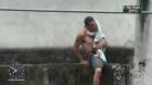 Homem de 28 anos causa terror ao ameaçar se jogar de prédio com o filho de um ano no colo